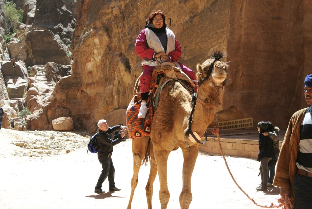 Eighty-seven year old Maria Rosa walked laps around us on the tour and even ventured and adventured on this camel!.jpg