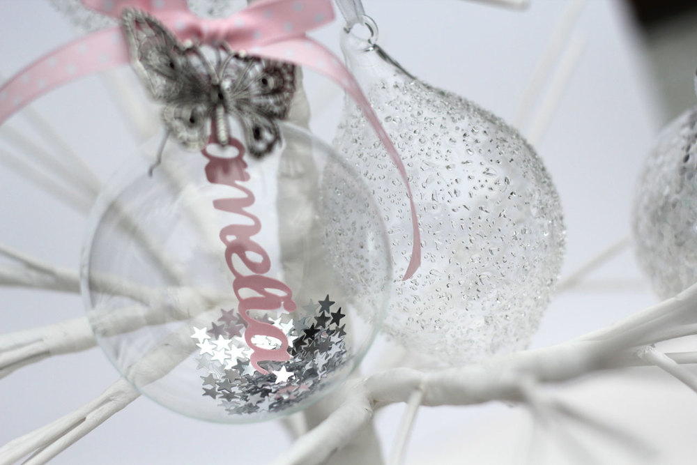 Personalised papercut bauble © studio seed. Photograph by Alex Carlile