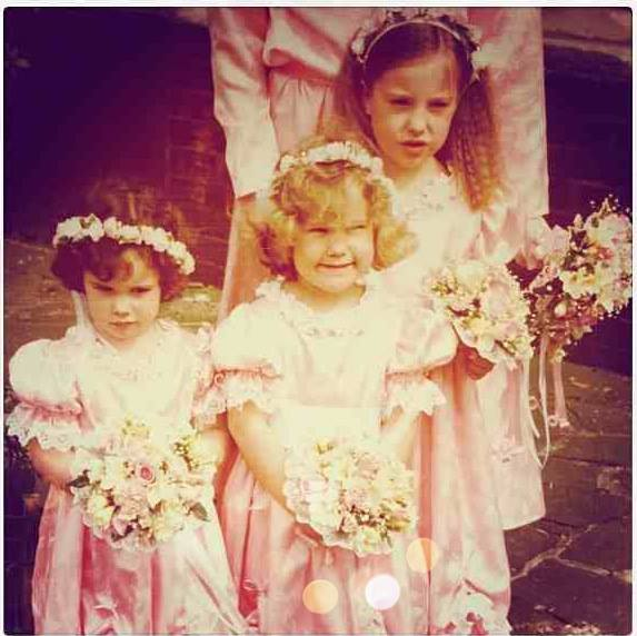 Two of my sisters and I being Bridesmaids quite some time ago. DIG those puff sleeves! (p.s I'm the crazy gurning one in the middle)