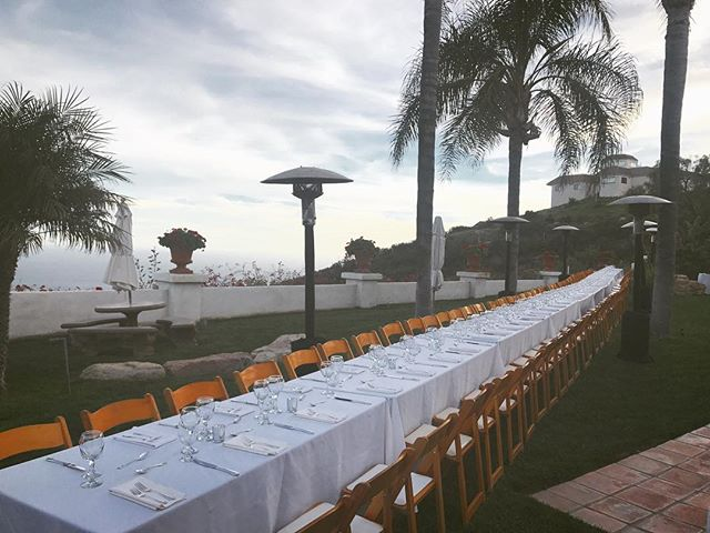 Getting ready for dinner at a long table with friends, in Malibu.