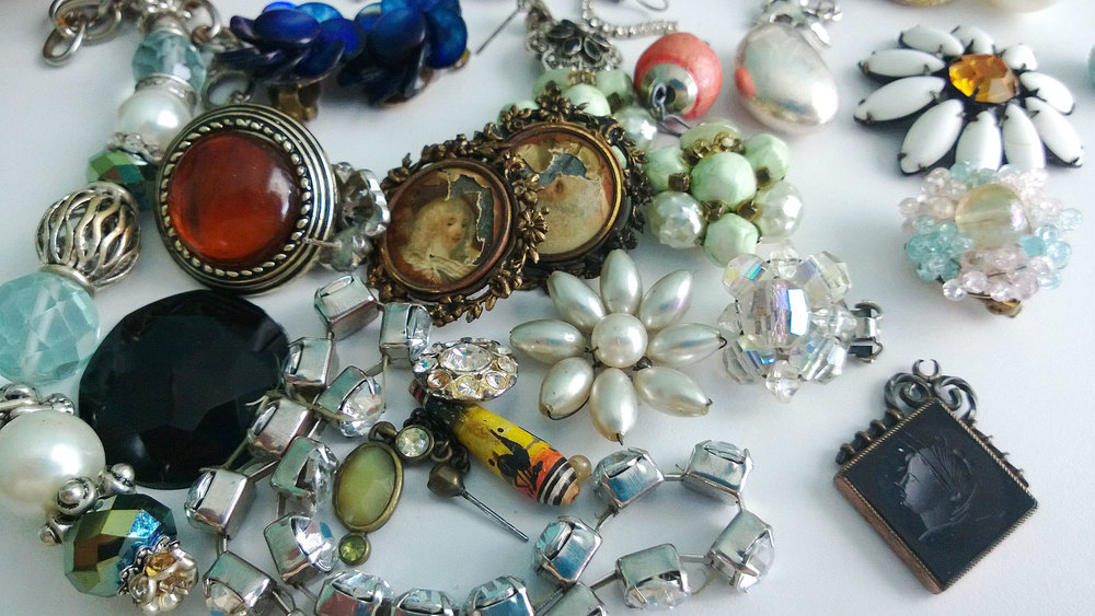 Vintage, classic, nice patinas, grandma beads, rich colors, and bling.