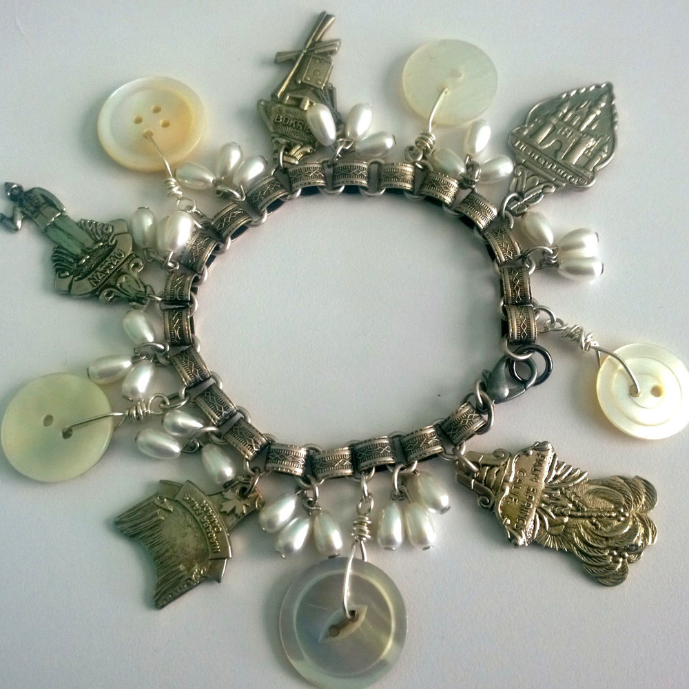 Travel Charm bracelet made from souvenir spoon tops, vintage buttons, silver plated bookchain and vintage new old stock costume pearls.