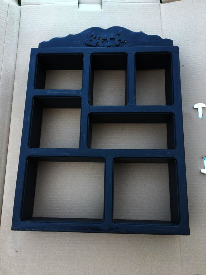 "A quick coat of black acrylic paint and it's looking better already. The ""bath"" plaque had to be disguised, though."