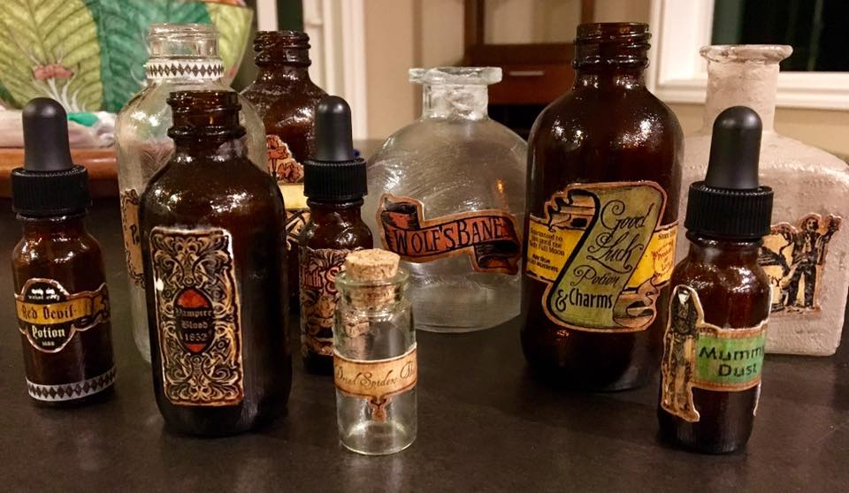 Potion bottles coming together! I didn't take pictures of how I did this, but I used decoupage glue to labels to the bottles and covered the entire bottles with the glue. On some bottles, I painted on top of the glue once it dried to give texture and aging to the surface.