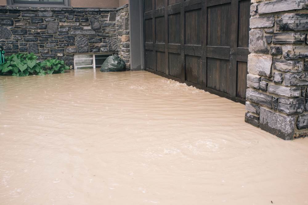 Air bubbling up  from the garage door and under the driveway. Standing in their driveway, the water was nearly knee deep here. 3000 block 7 Street SW.