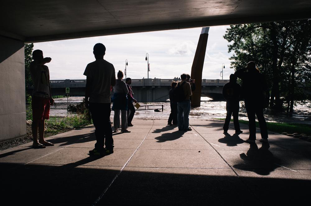 Sightseers.Under the 10th Street LRT bridge. Bow River.