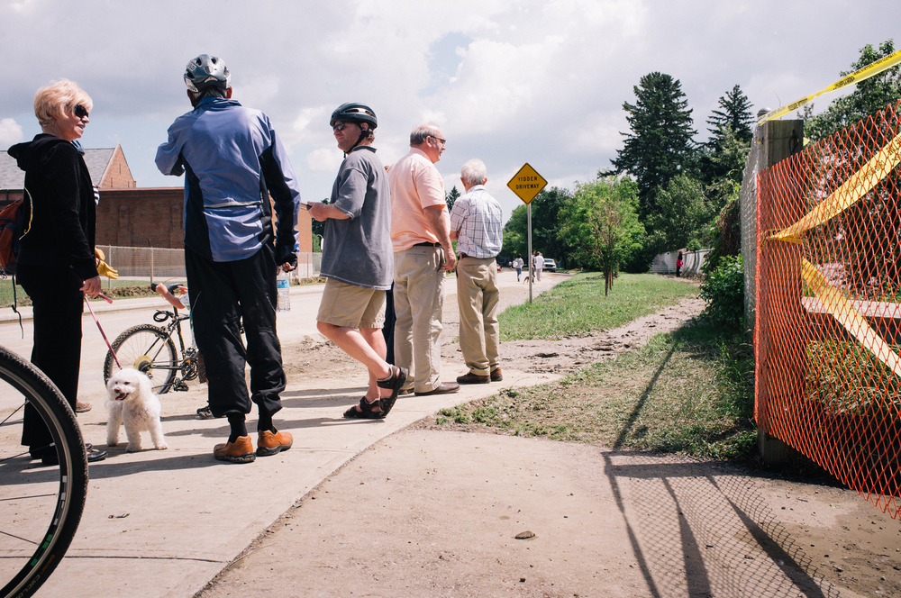 Pedestrians stop to photograph the footbridge on Sifton Boulevard.