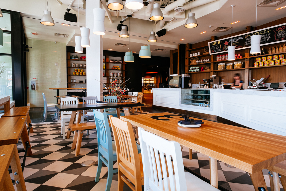 Osteria. The main-floor bar boasts a dedicated kitchen and brick pizza oven.