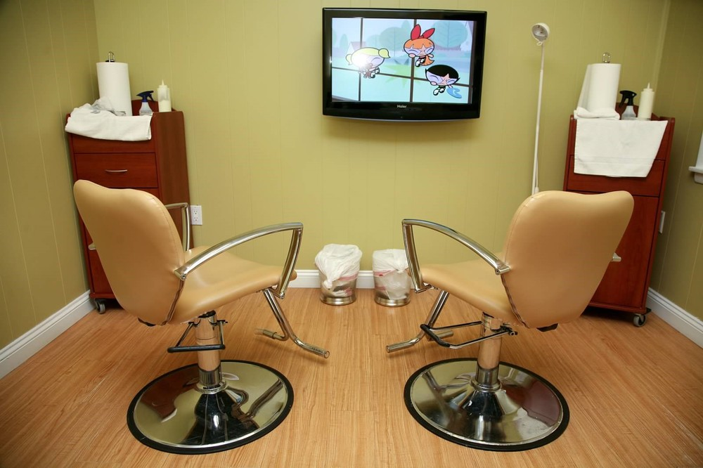 Head lice treatment room at Lice Be Gone (kid friendly--T.V. in each room, wifi, coffee, snacks provided)