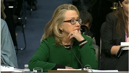 Hillary listens as Rand Paul throw conspiracy theories at her