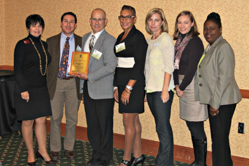 Dr. Jose Quero (third from left), the 2014 Rural Physician of the Year, with his colleagues from the Healthcare Network of Southwest Florida  Thursday, November 20 in Orlando, Fla. during the FRHA 21st Annual Educational Summit.