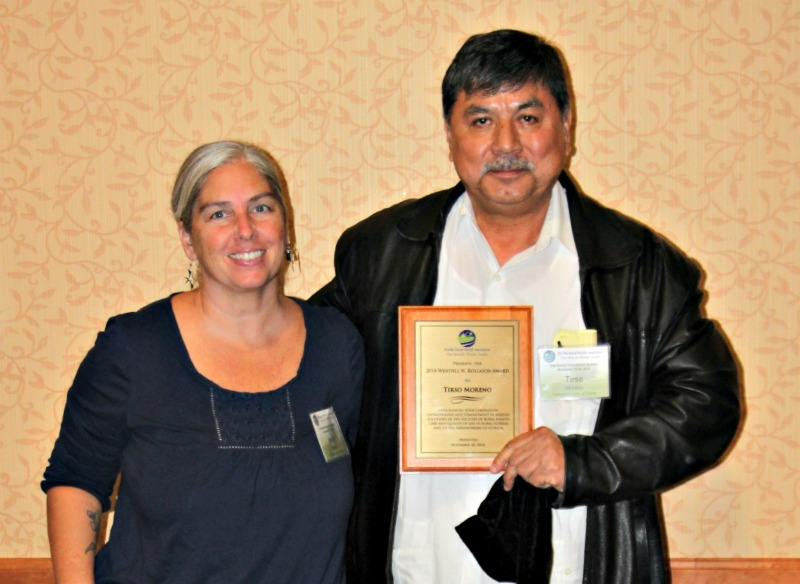 Tirso Moreno,  2015 recipient of the Wendell Rollason Award and  co-founder and general coordinator of the Farmworker Association of Florida, with his nominator, Holly Baker, at the FRHA Annual Educational Summit Thursday, Nov. 20.