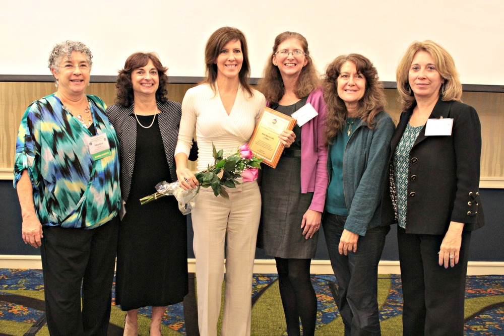 Dr. Mimi Balch, 2013 Wendell Rollason Award recipient, (third from left) poses with her ACORN Clinic coworkers during the FRHA Educational Summit in Gainesville.
