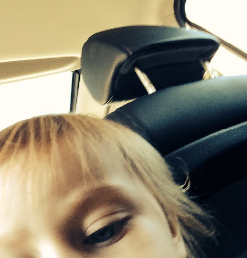 Cate, snapping selfies with my phone while I'm trying to get her out of the car.
