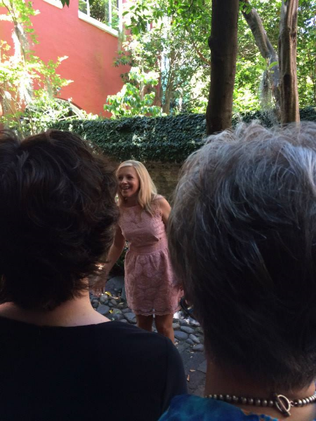 In the courtyard outside the theater, giving a pep talk. Photo by Anna Hartman.