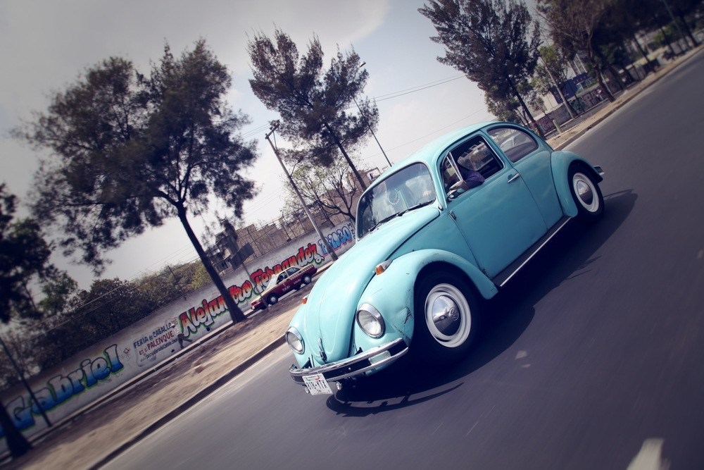 "A Volkswagon Beetle -- or ""Vocho"" -- on a highway outside of Mexico City."