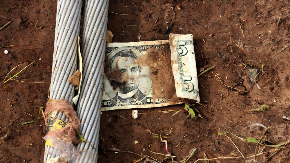 I walked a field for nearly 3 hours, looking at personal items carried by the powerful tornado. This $5 bill came to rest between two power lines.