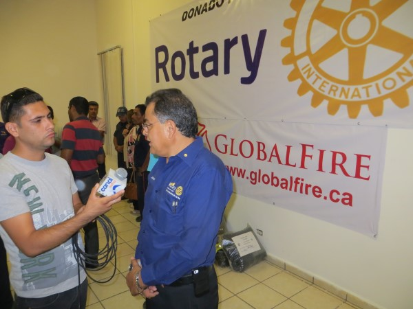 Pres Silva with GF Rotary background and medai.jpg