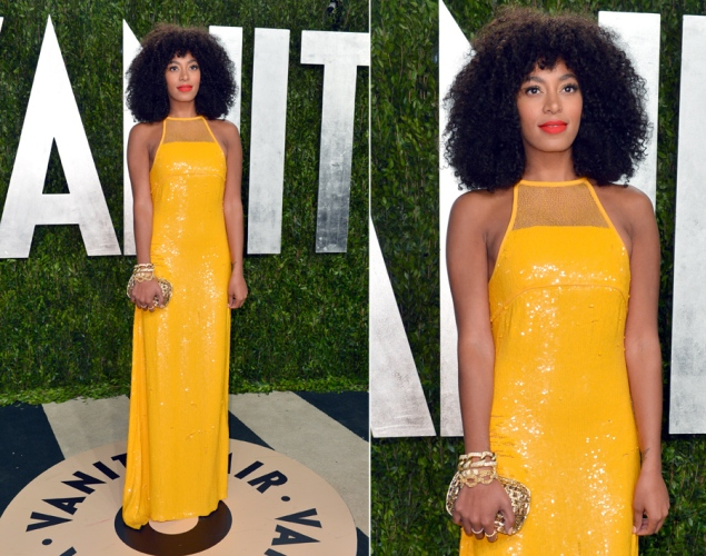 Solange is stunning in a Canary Yelow Emillio Pucci gown. Natural hair goes beautifully with this color and sleeveless cut..