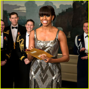First Lady Michelle Obama dazzles in this silver Naeem Khan gown, sophisticated pin-up with bangs...Amazing!