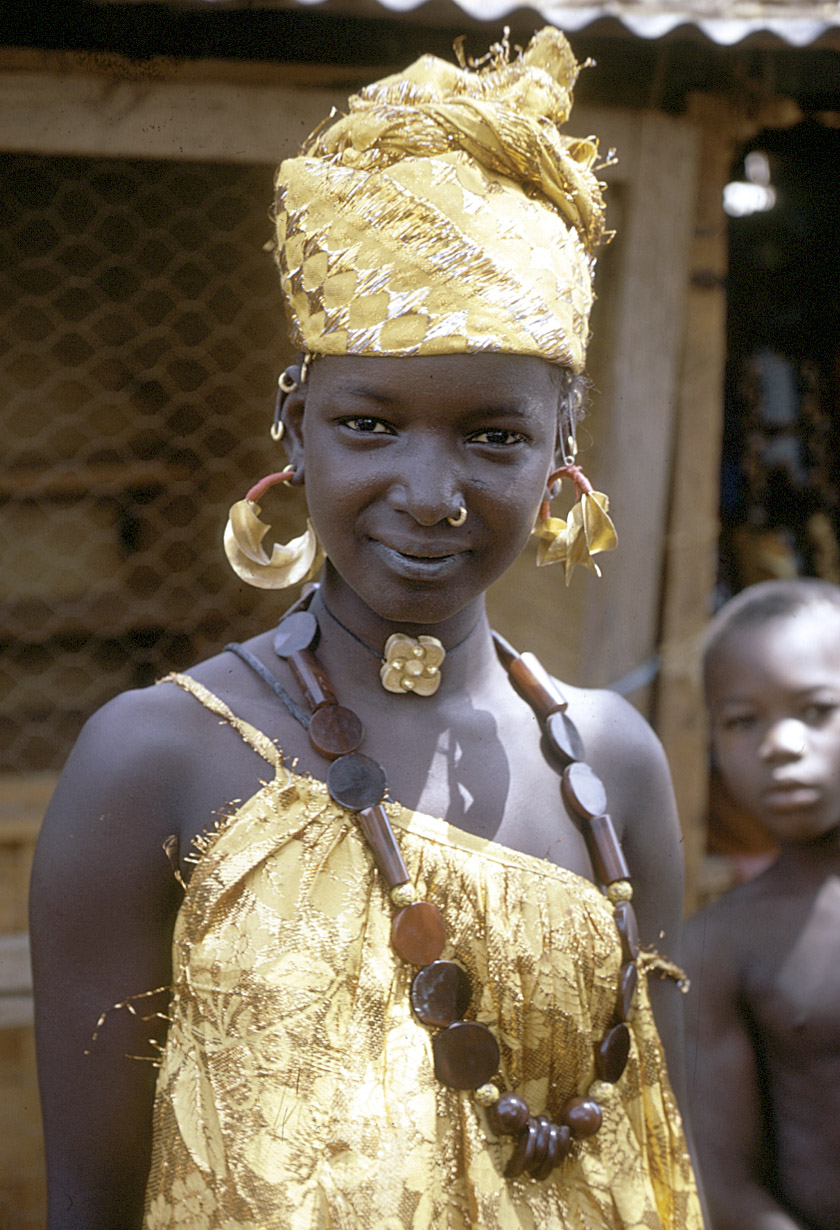 Beautiful Mali Princess , donning  a 14k gold traditional headdress, garment and jewerly.