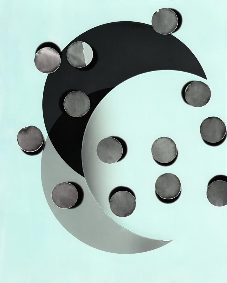 Circle work 17,  2013   cut solarised silver gelatin print (photogram) with toner     25.4 x 20.3 cm