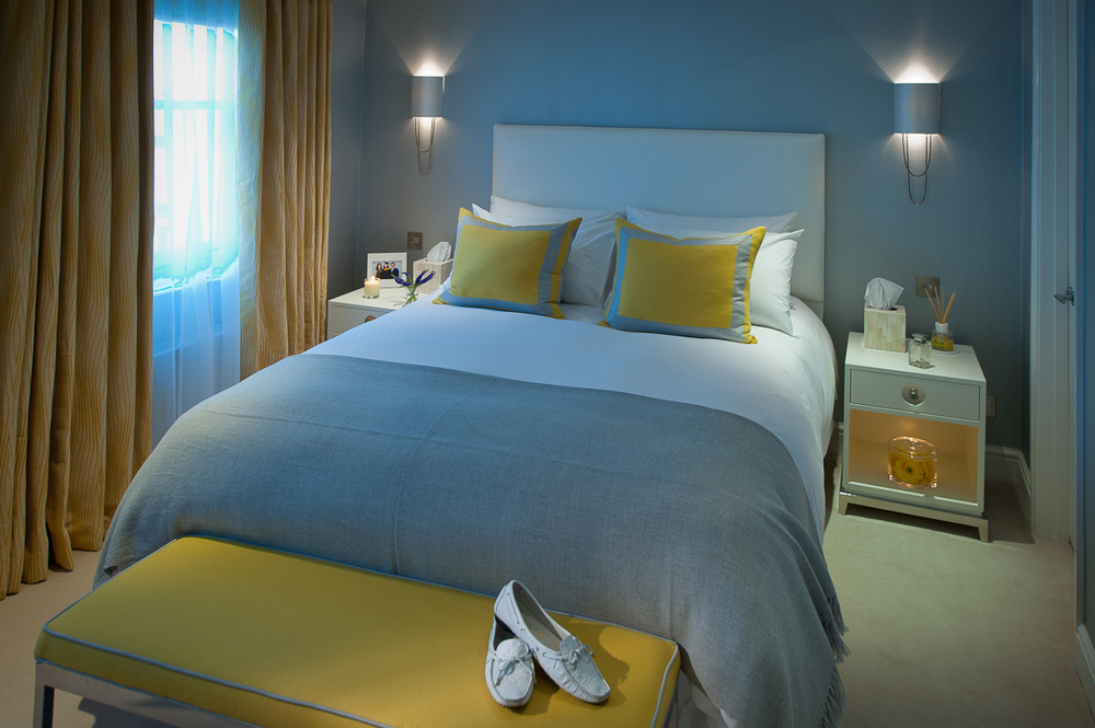 One of the guest bedrooms using a bright and fun colour scheme combined with elegant lighting and furniture.