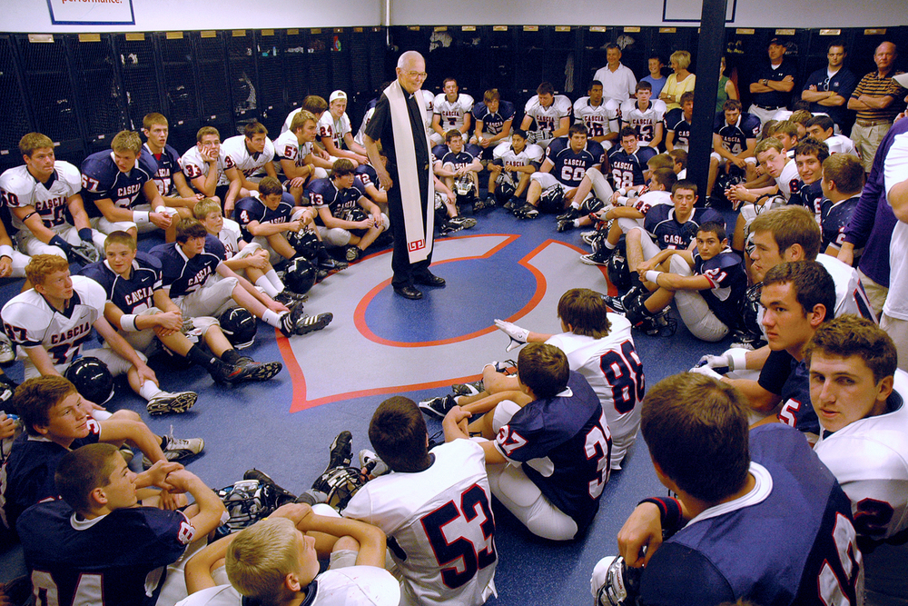 Tulsa, OK:  Rev. Ted Tack, O.S.A. blesses the Cascia Hall Commando Football team