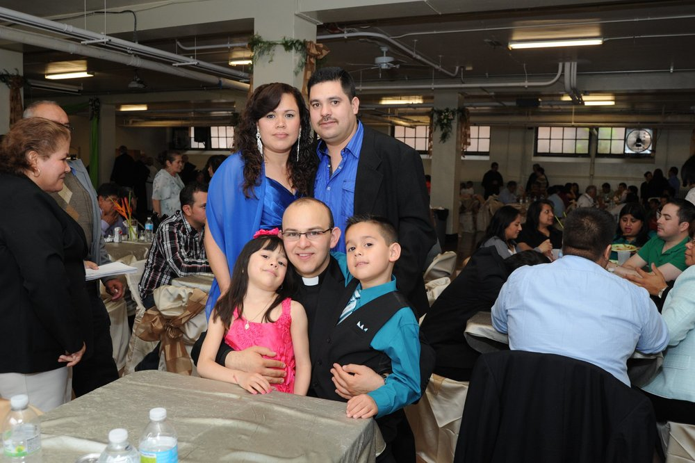 Fr. Homero Sánchez, O.S.A. with loved ones at the reception for his priesthood ordination