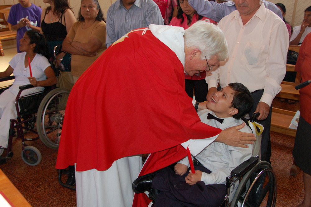 Fr. John Lydon, O.S.A., confirms a group of special needs children in Peru; People with disabilities tend to be largely marginalized in Peru