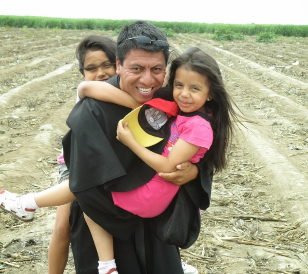 Fr. Wilder Vásquez, O.S.A. with some of the young children of Trujillo, Peru