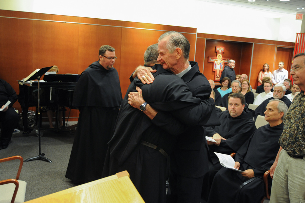 Bishop Dan Turley, O.S.A., congratulates Fr. Bernie Scianna, O.S.A., on his second term as Prior Provincial