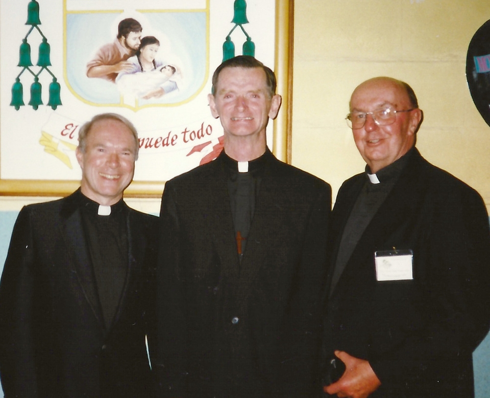 Father Ray Ryan, O.S.A. (right), with Father David L. Brecht, O.S.A. (left), the night before Father Dan Turley, O.S.A. (center), was ordained a bishop