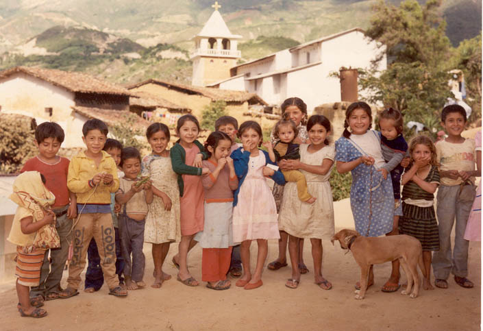 The Augustinians have been serving the needy children of Northern Peru for decades, like the ones seen here near the Church of Pacaipampa, seen in the background of the picture.