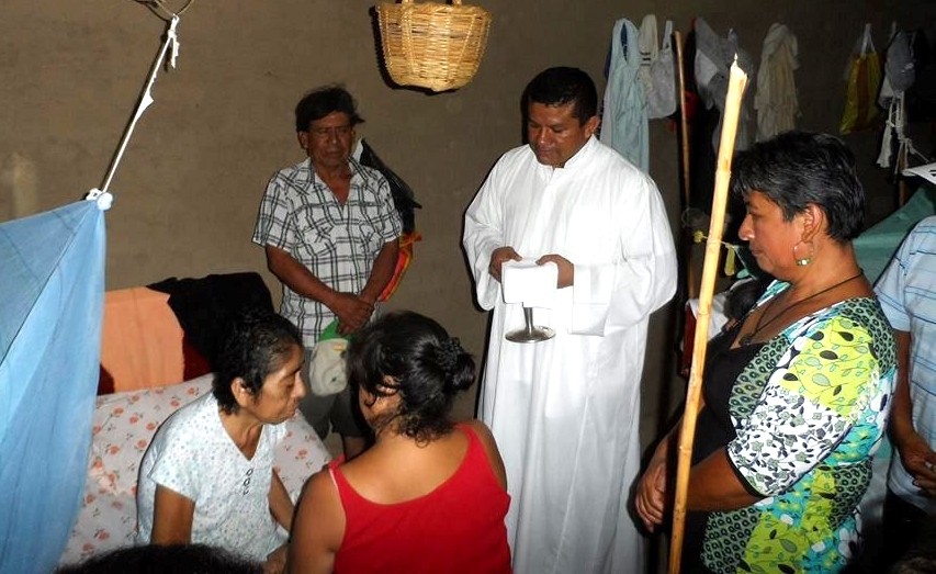 Fr. Fidel Alvarado, O.S.A., the Regional Vicar of the Augustinian missions in Northern Peru, visits with the sick