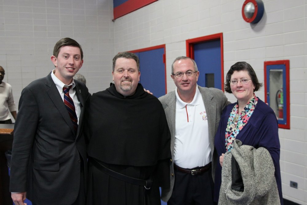 Members of the Carroll Family with Fr. Tom McCarthy, O.S.A.