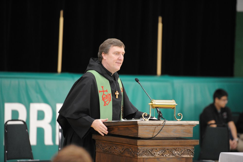 Father Merkelis is now a beloved priest on the campus of Providence Catholic High School in New Lenox, Illinois