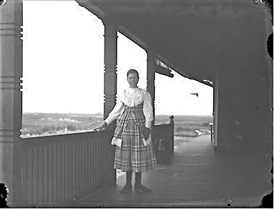 Hotel Long Beach 1890 Cottages Guest GirlOnPorch.JPG