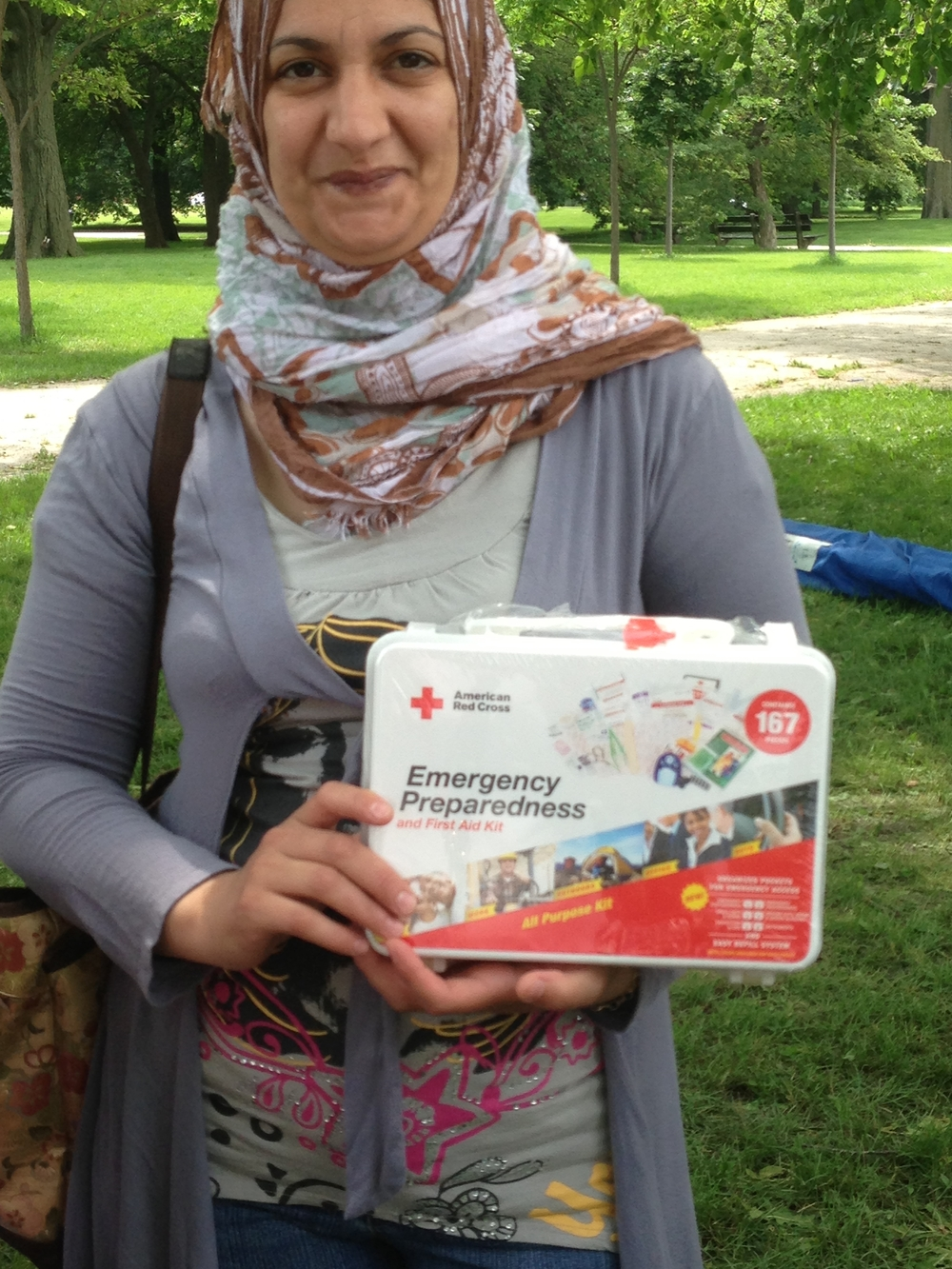 Attendee Gihan Ismail holds an Emergency First Aid Kit given by the Red Cross