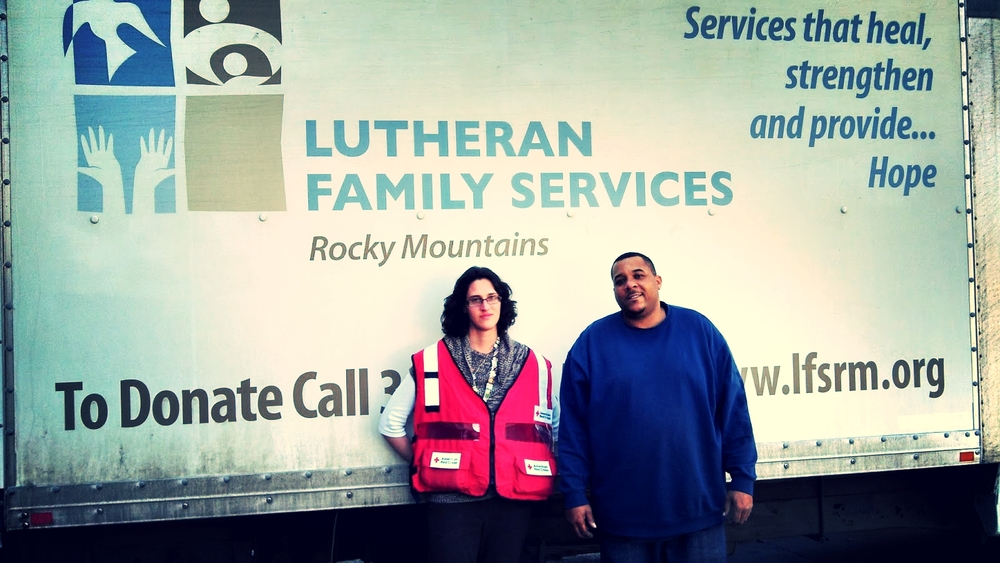 Tina Porter, Red Cross, and Horace from Lutheran Social Services