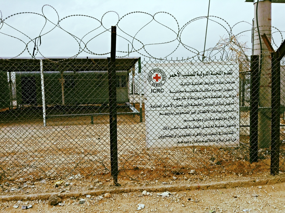 Sign outside of the International Committee of the Red Cross' Restoring Family Links office in Za'atari refugee camp that explains the services available.