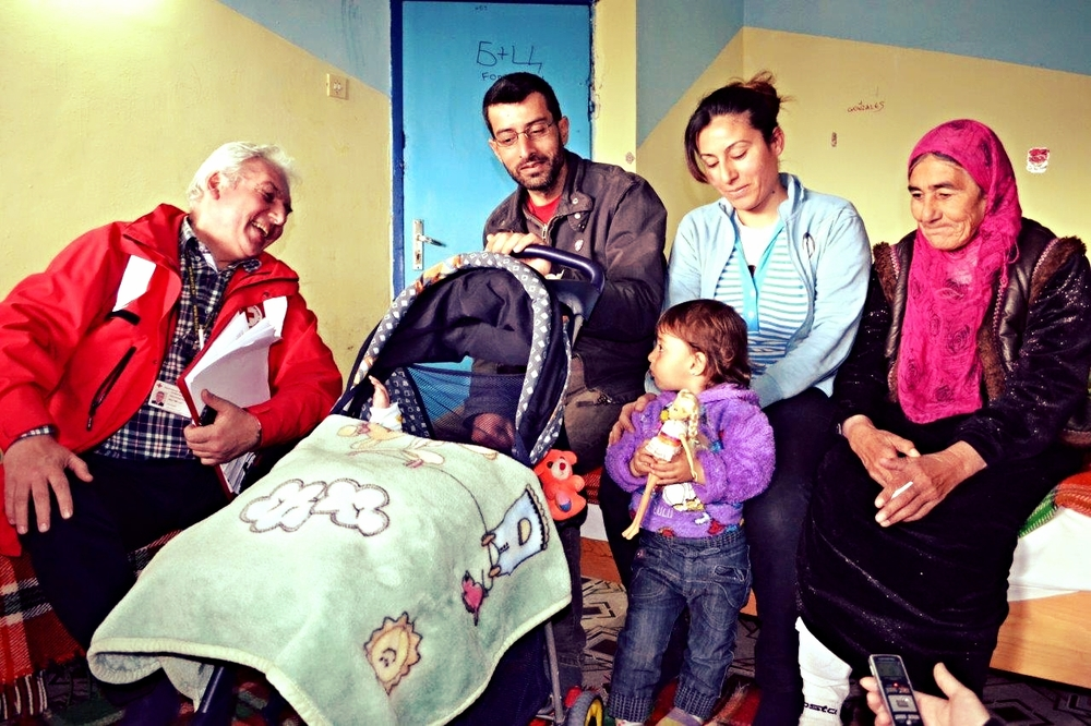 Hivro, Asra, and their family with the Bulgarian Red Cross