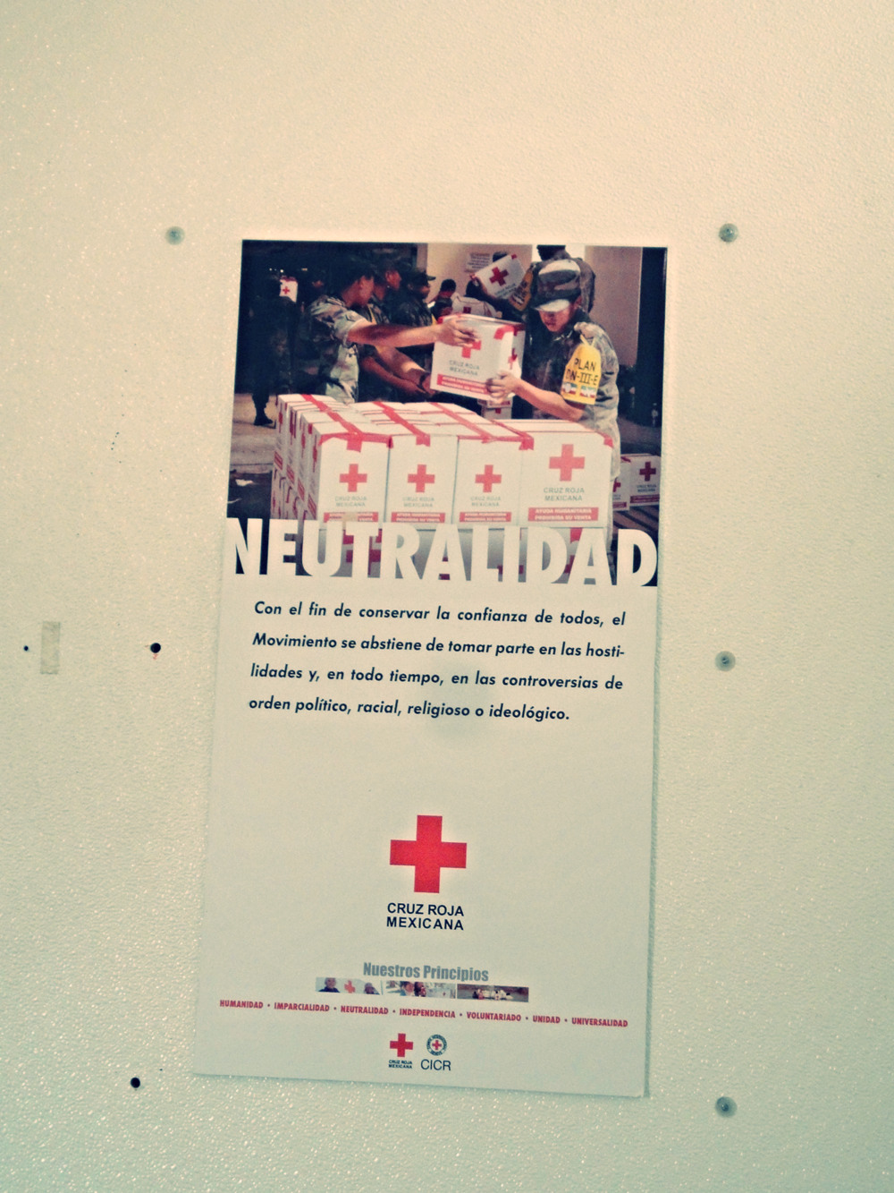 The Red Cross seven Fundamental Principles of humanity, impartiality, neutrality, independence, voluntary service, unity, and universality are posted inside the clinics with descriptions.