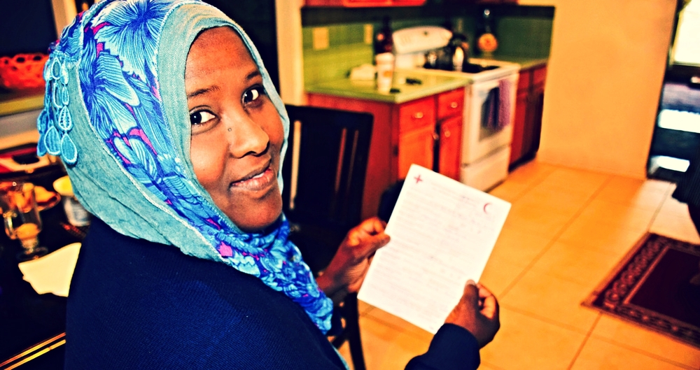 Photo: Amber Bierfreund/American Red Cross — Khadra Farah receives a Red Cross message from a sister she hasn't seen in 20 years.