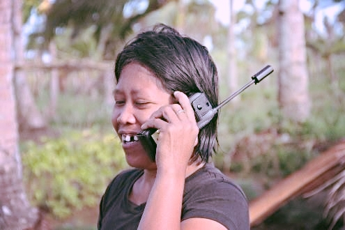 Satellite phones were used to help people reach their family and loved ones during the emergency phase. A total 35, 230 individuals were assisted through restoring family links. Photo credit: IFRC/Nichola Jones.
