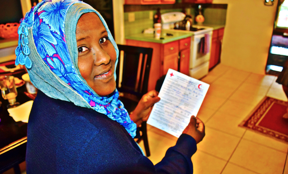 Amber Bierfreund/American Red Cross - Khadra Farah receives a Red Cross Message from a sister she hasn't seen in 20 years.
