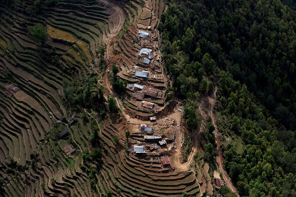 Collapsed houses and debris on steep terraced hillsides in Nuwakot are seen from a helicopter (Danish Siddiqui/Reuters)
