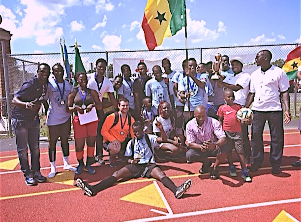 The winning team of the 2nd annual World Refugee Day Soccer Tournament. The team is from Ghana.