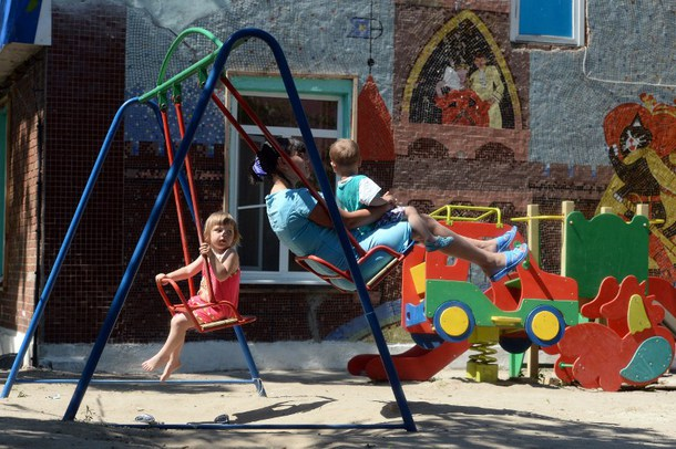 Ukrainian refugees at a playground in Russia (AFP)