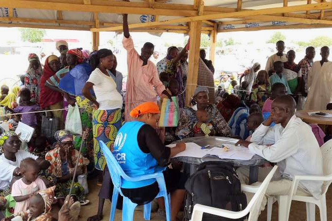 Newly-arrived Nigerian refugees register with UNHCR officials at Minawao Camp, northern Cameroon [UNHCR/D. Mbaiorem]